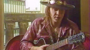 Rare Footage Of Stevie Ray Vaughan Shredding An Acoustic Guitar Emerges, And We Can't Stop Watching