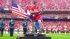 12-Year Old Channels Hendrix, Absolutley Shreds 'The Star Spangled Banner' Before A Football Game!