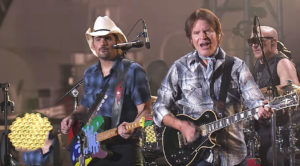 "In Honor Of Our Veterans, John Fogerty & Brad Paisley Played ""Proud Mary"" In Front Of The USS Iowa"