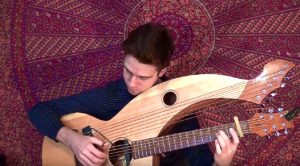 "Ozzy Osbourne's ""Mama, I'm Coming Home"" Is Reimagined On A Harp-Guitar And It's Mesmerizing"