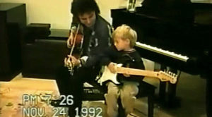 Home Video Of Neal Schon Giving Young Son Guitar Lesson Surfaces – Too Precious For Words!