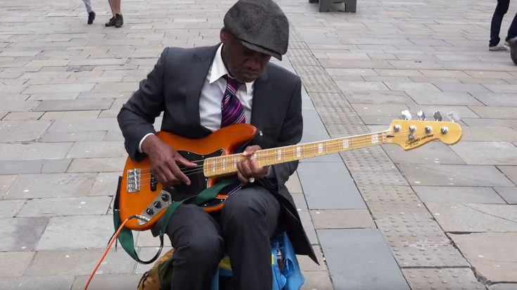 Street Performer Uses Bass Guitar To Channel Jimi Hendrix And We Can't Stop Watching!