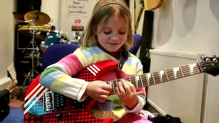 "7-Year-Old's Feet Barely Touch The Floor But She Shreds ""Sweet Child 'O Mine"" Like A Pro"