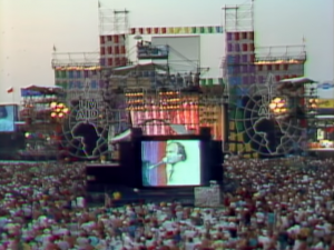 "A Stripped Down ""In The Air Tonight"" For 100K Live Aid Fans Is Superb"