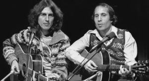 Watch George Harrison And Paul Simon Perform 'Here Comes The Sun'
